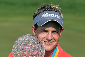 Luke Donald of England shows off the trophy after winning the Scandinavian Masters golf tournament in Barseback outside Malmo in Sweden, Sunday Aug. 1, 2004.
