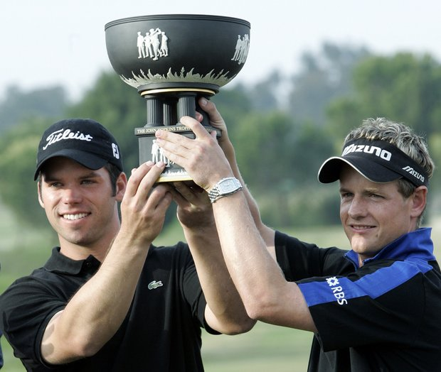 Englands Paul Casey, left and Luke Donald lift the trophy after winning the final of the World Cup Golf Championships in Seville, Spain Sunday Nov. 21, 2004.