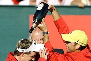 Sergio Garcia of Spain, right, pours champagne on last years winner Luke Donald of Great Britain, left, after winning the Omega European Masters golf tournament in Crans Montana, Switzerland, on Sunday, Sept. 4, 2005.