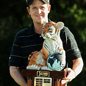 Luke Donald of England poses with the winner's trophy on the 18th green in the final round of the Target World Challenge at Sherwood Country Club in Thousand Oaks, Calif., Sunday, Dec. 11, 2005. Donald took the victory with a total score of 16-under-par 272, two strokes ahead of second-place finisher Darren Clarke.
