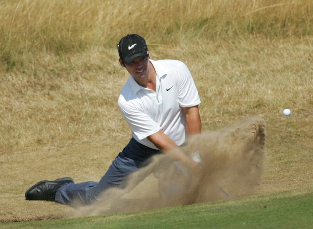 England's Paul Casey plays from a bunker during a practice round for the upcoming British Open Golf Championship at Royal Liverpool Golf Course at Hoylake, England Tuesday July 18, 2006.