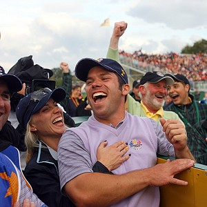 Europe's Paul Casey, center, is embraced by his partner Jocelyn Hefner as they watch a replay of his hole-in-one on the 14th tee after the foursomes match against Stewart Cink and Zach Johnson of the United States, on the second day of the 2006 Ryder Cup at the K Club golf course, Straffan, Ireland, Saturday Sept. 23, 2006. Casey and David Howell won the match 5 and 4.