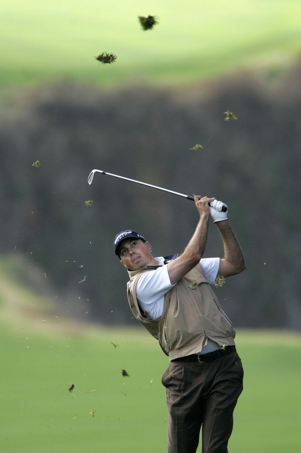 Matt Kuchar hits from out of bounds toward the 14th fairway at Pebble Beach golf links during the final round of the Pebble Beach National Pro-Am golf tournament in Pebble Beach, Calif., Sunday, Feb. 11, 2007.
