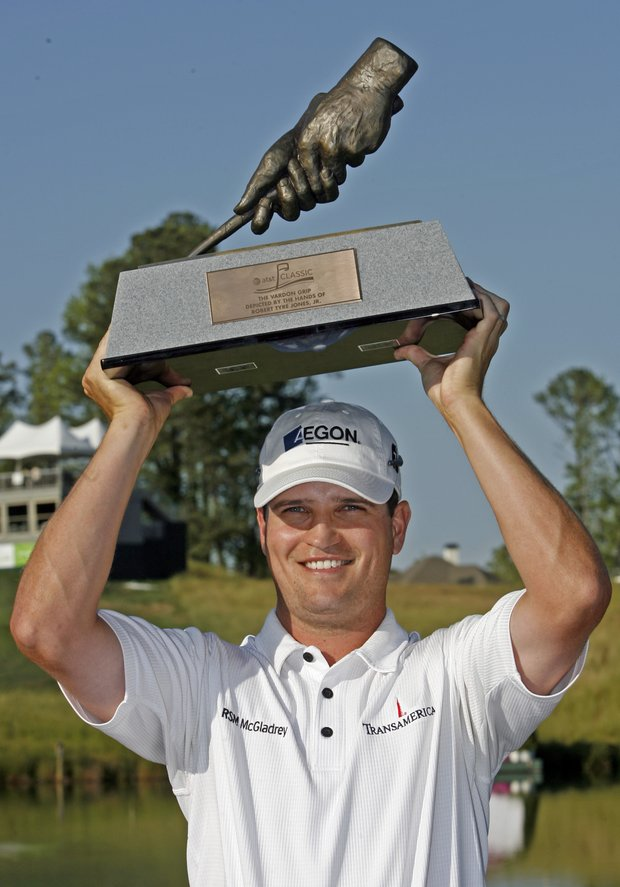 Zach Johnson poses with the trophy after winning the AT&T Classic golf tournament in Duluth, Ga., Sunday, May 20, 2007.