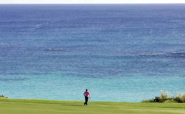Zach Johnson waits for other members of his group to hit on the 18th fairway during the PGA Grand Slam of Golf tournament, Tuesday Oct. 16, 2007, in Tucker's Town, Bermuda.