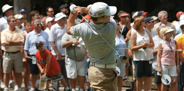 Spectators follow the ball of Zach Johnson as he tees off the sixth hole hole during the John Deere Classic on Friday, July 11, 2008 in Silvis, Ill.