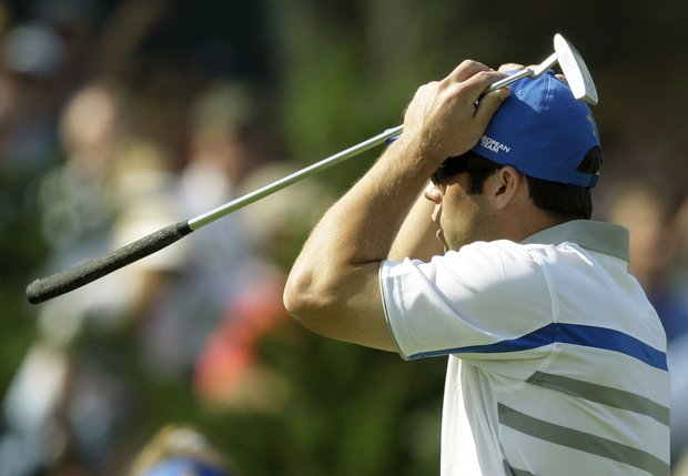 Europe's Paul Casey reacts to a missed putt on the 13th green during the opening round of the Ryder Cup golf tournament at the Valhalla Golf Club, in Louisville, Ky., Friday, Sept. 19, 2008.