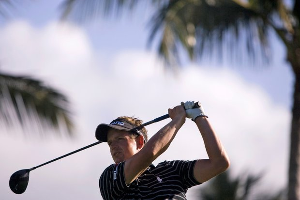 Luke Donald, of England, follows his drive off the first tee during the second round of the 2009 Sony Open golf tournament at the Waialae Country Club, Friday, Jan. 16, 2009 in Honolulu.