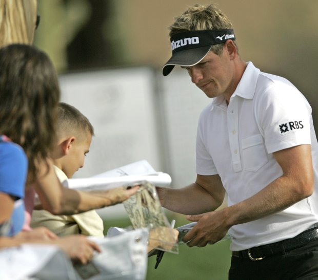 Luke Donald, of England, signs autographs on his way to the practice range at the World Golf Championships Accenture Match Play Championship Monday Feb. 23, 2009 in Marana, Ariz.