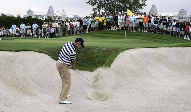 Zach Johnson hits from a sand trap on the 10th hole during the first round of The Barclays golf tournament, Thursday, Aug. 27, 2009, in Jersey City, N.J.