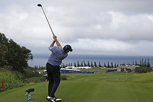 Matt Kuchar follows his drive from the 18th tee during the first round of the SBS Championship golf tournament in Kapalua, Hawaii, Thursday, Jan. 7, 2010. Kuchar shot a six-under-par 67 to finish tied for second place and one stroke off the lead.