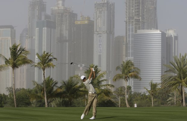 South Africa's Charl Schwartzel plays a ball on the 13th hole during the 1st round of Dubai Desert Classic in Dubai, United Arab Emirates, Thursday, Feb. 4, 2010.