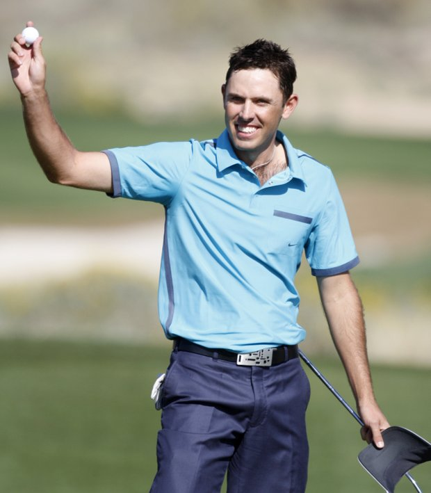 Charl Schwartzel, of South Africa, celebrates his victory over Jim Furyk in the second round of the Match Play Championship golf tournament Thursday, Feb. 18, 2010, in Marana, Ariz.