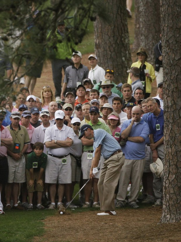 Matt Kuchar hits out of the rough off the seventh fairway during the first round of the Masters golf tournament in Augusta, Ga., Thursday, April 8, 2010.