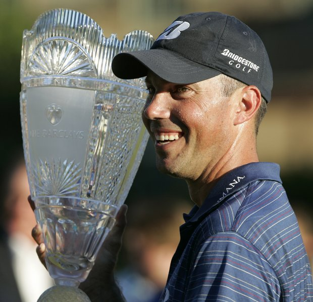Matt Kuchar raises the trophy after defeating Martin Laird of Scotland in a sudden death playoff after the final round of The Barclays golf tournament, Sunday, Aug. 29, 2010, in Paramus, N.J. Kutcher won after making birdie on the first playoff hole.