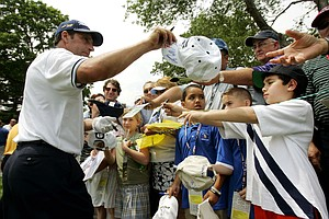 Jose Maria Olazabal signs autographs during a practice round for the 2006 U.S. Open.