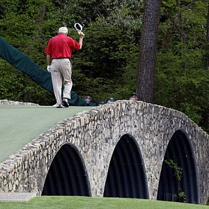Arnold Palmer walks across the Hogan Bridge on the 12th fairway for the final time in Masters competition during the second round of the Masters tournament at Augusta National Golf Club in Augusta, Ga., April, 9, 2004.