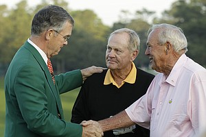 Billy  Payne, left, chairman of the Augusta National Golf Club, shakes hands with Jack Nicklaus and Arnold Palmer, right, during the ceremonial first tee shots of the first round of the Masters in Augusta, Ga., April 8, 2010.