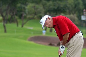 Arnold Palmer putts for a 10-foot birdie on the second playoff hole to earn a skin worth $100,000 during the Champions Skins Game at the Wailea Gold Course in Wailea, Hawaii, Jan. 14, 2007.