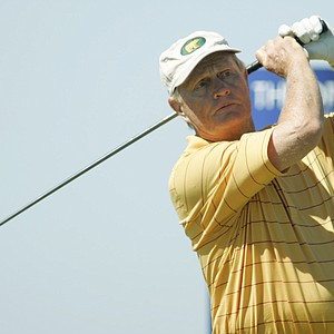 Jack Nicklaus tees off during a practice round for the British Open on the Old Course at St. Andrews in Scotland, July 11, 2005. Nicklaus said that the Open will be his final major tournament.