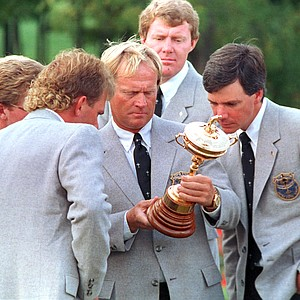 Jack Nicklaus, center, captain of the U.S. Ryder Cup team, looks over the inscription of the cup following the opening ceremonies at Muirfield Golf Club in Dublin, Ohio, Sept. 24, 1897. Other team members include: Payne Stewart, left, Andy Bean, rear, and Curtis Strange, right.