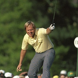 Jack Nicklaus watches his putt drop for birdie on the 17th hole at The Masters in Augusta, Ga., April 13, 1986. The shot gave him the lead and he would go on to win his sixth Masters title.
