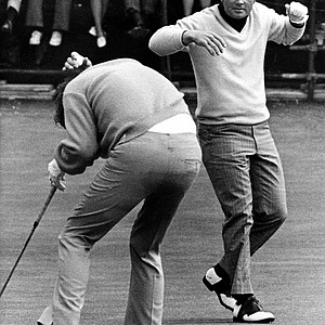 Doug Sanders, left, ducks as Jack Nicklaus, right, throws his putter high in the air during the British Open at St. Andrews, Scotland, July 7, 1970.