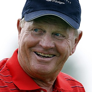 Jack Nicklaus smiles after teeing off on the fourth hole during the Champions for Change Golf Challenge at Harbor Shores Golf Club in Benton Harbor, Mich., Aug. 10, 2010.