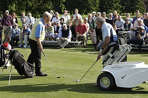 Jim Martinson, right, who lost both his legs fighting in Vietnam, uses a special golf cart to line up a shot during a clinic at the Tacoma Country & Golf Club with Jack Nicklaus, left, in Lakewood Wash. Nicklaus is contributing his course expertise to build a new nine holes at the nearby American Lake Veterans Golf Course, where Martinson and other veterans can play and recover from injuries.