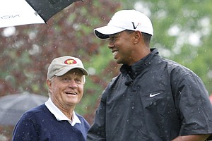 Jack Nicklaus, left, shares a laugh with Tiger Woods, right, on the 12th tee during the Memorial Skins Game in Dublin, Ohio. Nicklaus still believes Woods will break his record of 18 professional majors.