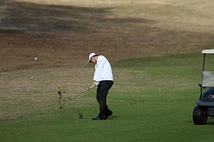Jarrod Barsamian hits a shot at No. 10 during the Hooters Tour Winter Series event at Timacuan Golf Club.