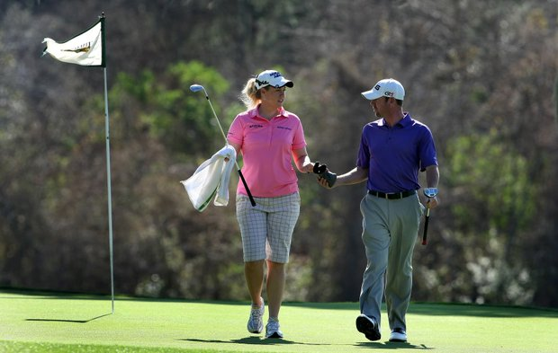 LPGA Tour player Brittany Lincicome acts as caddy for her friend Ryan Gildersleeve during the Hooters Tour Winter Series event at Timacuan Golf Club.