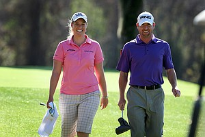 LPGA Tour player, Brittany Lincicome, left, shares a laugh with her friend, Ryan Gildersleeve, as they come off the 10th green Timacuan Golf Club. Lincicome who played in a recent Hooters Tour Winter Series event was Gildersleeve's caddy today.