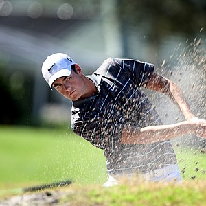 Matt Hill, former NCAA Champion, hits a bunker shot at No. 11.