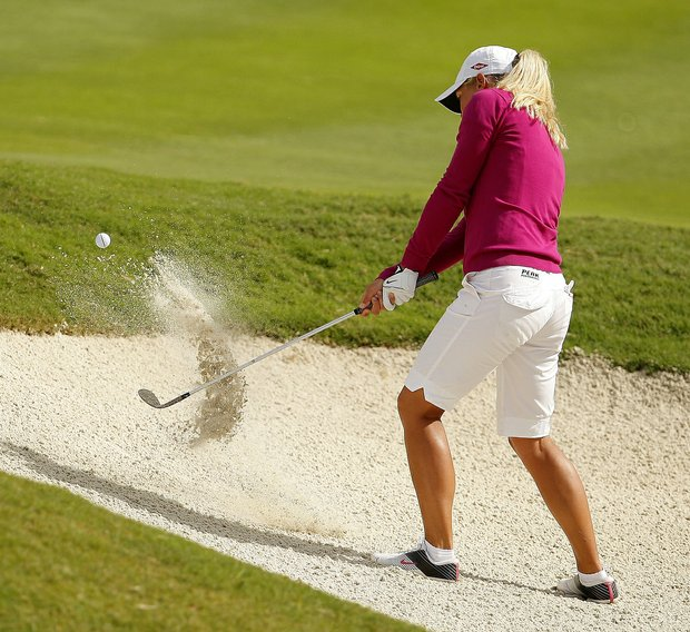 Suzann Pettersen hits out of the bunker at No. 8 during the ADT Championship LPGA Playoffs at Trump International Golf Club.