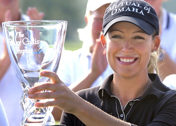 Cristie Kerr raises the Bruce Callis Trophy after winning the LPGA State Farm Classic in Springfield, Ill., Sunday, Sept. 5, 2004. Kerr shot a tournament- record 24-under-par 264 for the four-day event.