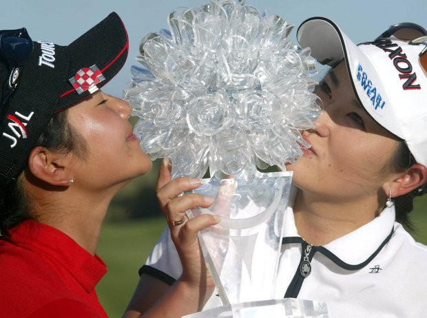 Japan's golfers Ai Miyazato, left, and Rui Kitada, right, pose with their trophy after winning the Women's World Cup of Golf trophy at the The Links in Fancourt Country Club in George, South Africa, Sunday, Feb. 13, 2005. Japan won by 2-strokes.