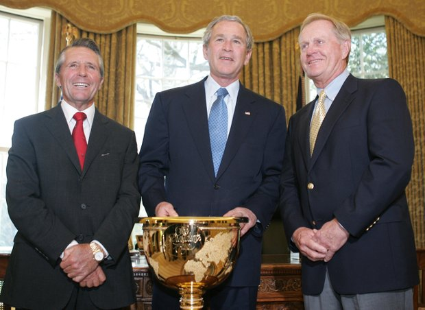 President Bush meets the captains of Presidents Cup golf teams Jack Nicklaus, right, U.S. captain, and Gary Player, left, international captain, Wednesday, April 13, 2005 in the Oval Office of the White House.