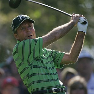 Gary Player of South Africa hits his tee shot from the fourth hole during first round play of the Masters golf tournament at the Augusta National Golf Club in Augusta, Ga., Thursday, April 6, 2006.