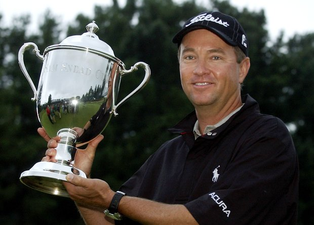 Davis Love III holds the Sam Snead Cup on the 18th green after winning the Chrysler Classic of Greensboro at Forest Oaks Country Club near Greensboro, N.C. Sunday, Oct. 8, 2006.