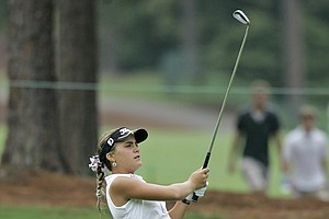 Twelve-year-old Alexis Thompson, of Coral Springs, Fla., hits along the 18th fairway during her second round at the 2007 Women's U.S. Open golf championship in Southern Pines, N.C., Saturday, June 30, 2007.