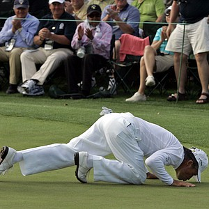 Gary Player of South Africa kisses the 18th green during the second round of the 2008 Masters golf tournament at the Augusta National Golf Club in Augusta, Ga., Friday, April 11, 2008. This is Player's 51st Masters appearance.