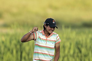 Yani Tseng, of Taiwan, pumps her fist as she sinks her putt on the 18th hole of a sudden death playoff against Maria Hjorth, of Sewden, to win the LPGA Championship golf tournament at Bulle Rock Golf Course in Havre de Grace, Md., Sunday, June 8, 2008.