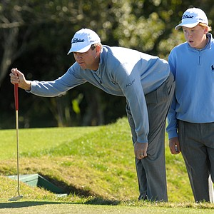 Davis Love III, left, and his son, Dru, line up their putt on the fourth hole during the final round of the Del Webb Father/Son Challenge in ChampionsGate, Fla., Sunday, Dec. 7, 2008.