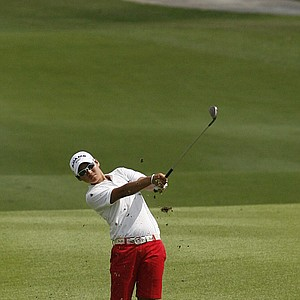 Yani Tseng of Taiwan shoots a drop ball on the 2nd fairway during the first round of the HSBC Women's Champions Golf tournament held at the Tanah Merah Country Club on Thursday March 5, 2009 in Singapore.