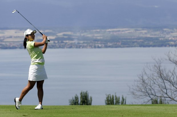 Ai Miyazato of Japan plays on the fifth hole during the third round of the Evian Masters women's golf tournament in Evian, eastern France, Saturday, July 25, 2009.