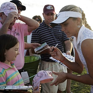 Amateur golfer Alexis Thompson, 14, signs autographs for fans following her second round of the Navistar LPGA Classic golf tournament at the Robert Trent Jones Golf Trail at Capitol Hill in Prattville, Ala., on Friday, Oct. 2, 2009.