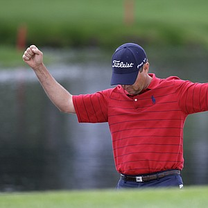 Davis Love III raises his arms after sinking a shot for birdie from a sand trap on the 17th hole during the second round of the Arnold Palmer Invitational golf tournament at Bay Hill in Orlando, Fla., Friday, March 26, 2010.