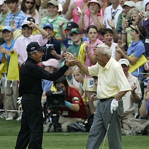 Gary Player, left, congratulates Arnold Palmer after his birdie on the ninth hole during the par-3 tournament at the Masters golf tournament in Augusta, Ga., Wednesday, April 7, 2010.