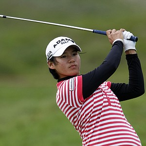 Taiwan's Yani Tseng plays an approach shot on the third hole during the third round of the Womens British Open, at Royal Birkdale Golf Club, Southport, England, Saturday July 31, 2010.